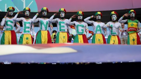 Senegal fans salute before the match against Colombia.