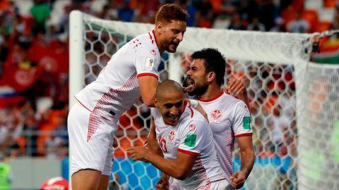 Tunisia's Wahbi Khazri, center, celebrates with his teammates after scoring the winning goal against Panama on June 28. Tunisia won 2-1.