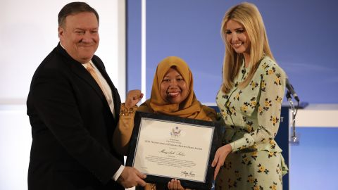 Secretary of State Mike Pomeo and Special Advisor to the President Ivanka Trump present Maizidah Salas of Indonesia with an award for her advocacy work during an event marking the release of the Trafficking in Persons report at the State Department June 28, 2018 in Washington, DC.