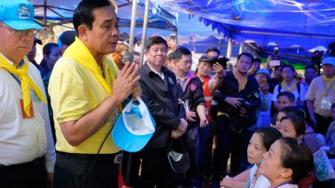 Thai Prime Minister Prayut Chan-O-Cha speaks to the family members of the missing children and their coach on Friday.