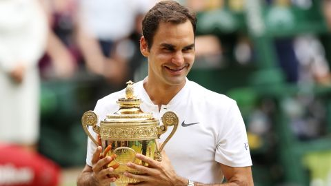 LONDON, ENGLAND - JULY 16:  Roger Federer of Switzerland celebrates victory with the trophy after the Gentlemen's Singles final against  Marin Cilic of Croatia on day thirteen of the Wimbledon Lawn Tennis Championships at the All England Lawn Tennis and Croquet Club at Wimbledon on July 16, 2017 in London, England.  (Photo by Julian Finney/Getty Images)