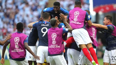 French players celebrate after Benjamin Pavard tied the match at 2-2.
