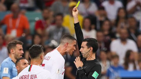 Portugal's Cristiano Ronaldo receives a yellow card from referee Cesar Ramos near the end of the match.