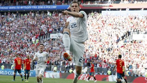Russia's Artem Dzyuba celebrates after scoring against Spain in the first half.
