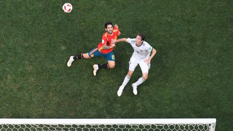 Spain's Isco and Russia's Mario Fernandes vie for the ball.