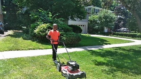 Reggie Fields, 12, mows a lawn on Sunday in Maple Heights, Ohio. His mom says he's picked up about 20 new customers since someone called the police on him for mowing the wrong yard.