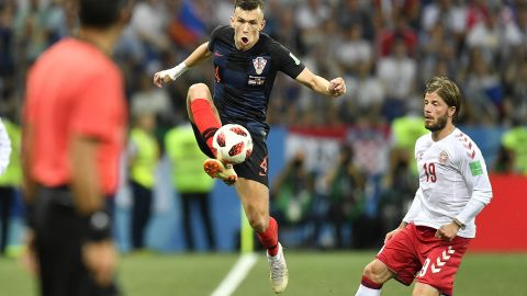 Croatia's Ivan Perisic stops the ball during the Denmark match.