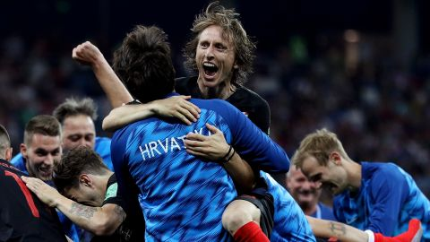 Croatia's Luka Modric celebrates with teammates after their victory over Denmark on July 1. Croatia won on penalties after the match ended 1-1.