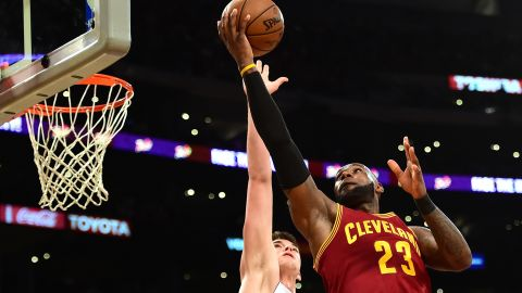 LOS ANGELES, CA - MARCH 19:  LeBron James #23 of the Cleveland Cavaliers attempts a layup over Ivica Zubac #40 of the Los Angeles Lakers at Staples Center on March 19, 2017 in Los Angeles, California.  NOTE TO USER: User expressly acknowledges and agrees that, by downloading and or using this photograph, User is consenting to the terms and conditions of the Getty Images License Agreement.  (Photo by Harry How/Getty Images)