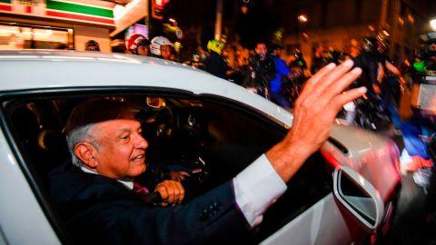 Andres Manuel Lopez Obrador waves to his supporters after his landslide victory.
