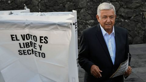 """Mexico's presidential candidate Andres Manuel Lopez Obrador for the """"Juntos haremos historia"""" party, casts his vote during general elections, in Mexico City, on July 1, 2018. - Sick of endemic corruption and horrific violence fueled by the country's powerful drug cartels, Mexicans go to the polls seeking for any alternative to the two parties that have governed for nearly a century: the ruling Institutional Revolutionary Party (PRI) and the conservative National Action Party (PAN). (Photo by ALFREDO ESTRELLA / AFP)        (Photo credit should read ALFREDO ESTRELLA/AFP/Getty Images)"""