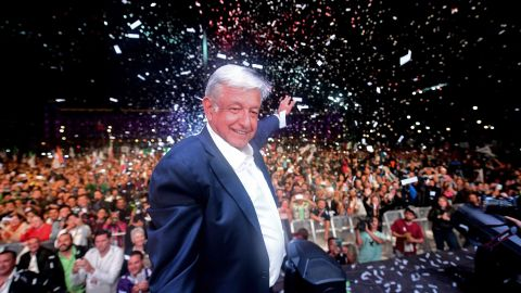 """Newly elected Mexico's President Andres Manuel Lopez Obrador (C), running for """"Juntos haremos historia"""" party, cheers his supporters at the Zocalo Square after winning general elections, in Mexico City, on July 1, 2018. (Photo by PEDRO PARDO / AFP)        (Photo credit should read PEDRO PARDO/AFP/Getty Images)"""