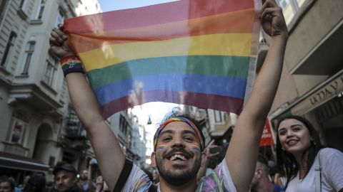 An activist brandishes a rainbow flag during the banned march.