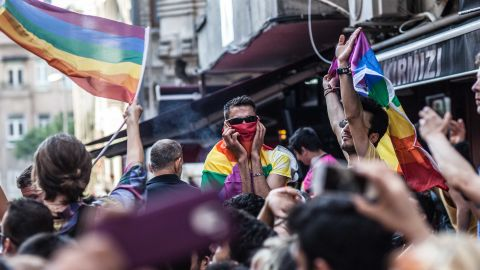LGBTI activists shout slogans and hold rainbow flags in Instanbul's city center.
