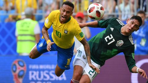 Brazilian star Neymar is fouled by Mexican defender Edson Alvarez during their round-of-16 match on July 2. Brazil won 2-0.