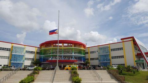 The flag in front of Tanauan City Hall flies at half-staff following the murder of Mayor Antonio Halili.