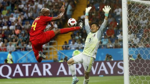 Belgium defender Vincent Kompany nearly scores in the first half.