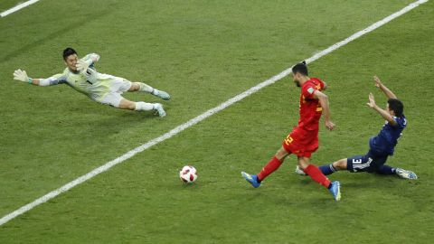 Chadli slides the ball past Japan goalkeeper Eiji Kawashima to finish off Belgium's 3-2 comeback victory. It is the first time since 1970 that a team has come back from two goals down to win in the World Cup knockout stage.