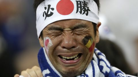 A Japan supporter cries after the match.