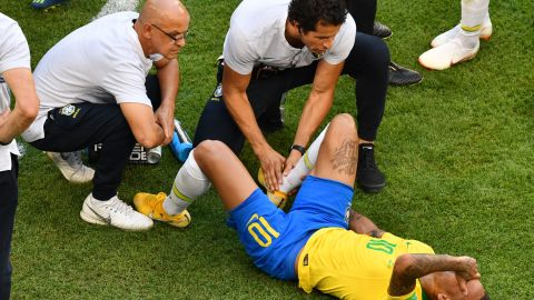 Neymar receiving treatment on the pitch.