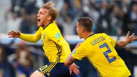 Sweden's Emil Forsberg, left, celebrates after scoring against Switzerland on July 3. Sweden won 1-0 to advance to the quarterfinals.