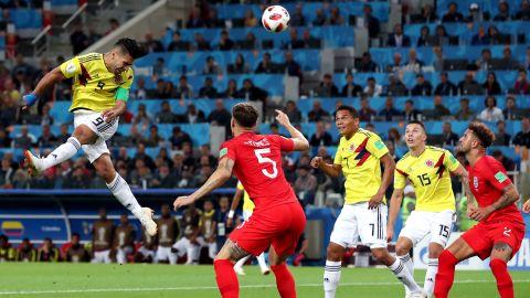 Colombian striker Radamel Falcao heads the ball toward goal on July 3.