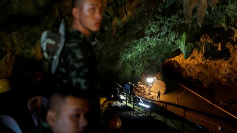 Soldiers and rescuers work outside the cave complex on July 1.