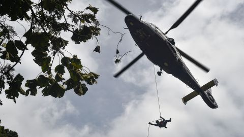 A Thai Air Force worker drops near a possible cave opening on June 30.