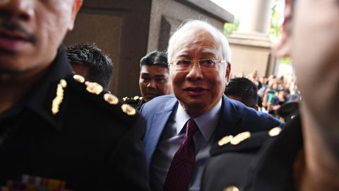 Former Malaysian prime minister Najib Razak (C) arrives for a court appearance at the Duta court complex in Kuala Lumpur on July 4, 2018. - Najib, 64, was detained on July 3 as the government of Prime Minister Mahathir Mohamad intensified a probe on corruption during his rule, including the alleged siphoning off of billions of dollars from state fund 1MDB. (Photo by MOHD RASFAN / AFP)        (Photo credit should read MOHD RASFAN/AFP/Getty Images)