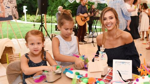 Alba with her daughters Haven and Honor at an Honest Company event in East Hampton, New York, in August 2017.