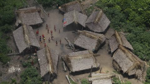 An aerial view of a village called Irotatheri as Yanomami Indians stand at the main courtyard in Venezuela's Amazon region.