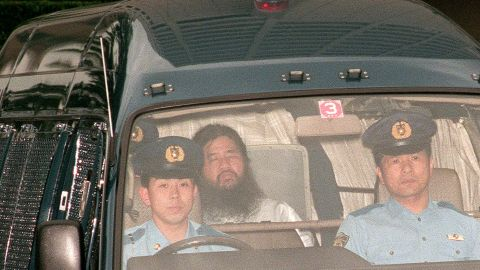 In this picture taken on July 19, 1995, Shoko Asahara (C), head of the doomsday cult Aum Shinrikyo, is transferred from Tokyo police headquarters to Tokyo District Court for questioning. Seven of 13 members of a cult behind a deadly sarin attack in Tokyo's subway have been moved to different prison facilites, the justice ministry said on March 15, 2018, as speculation grows that they could soon be executed. The official declined to discuss exactly which of the members were moved out of Tokyo, but local media said the cult's guru Shoko Asahara remained in the Japanese capital. / AFP PHOTO / JIJI PRESS / JIJI PRESS / Japan OUT        (Photo credit should read JIJI PRESS/AFP/Getty Images)