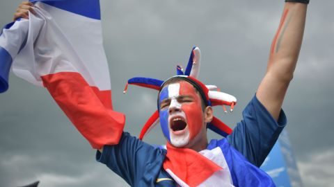 A France supporter cheers ahead of the match.