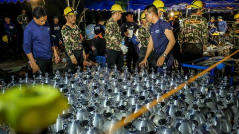 Scuba oxygen tanks are delivered to the cave rescue site on July 1.