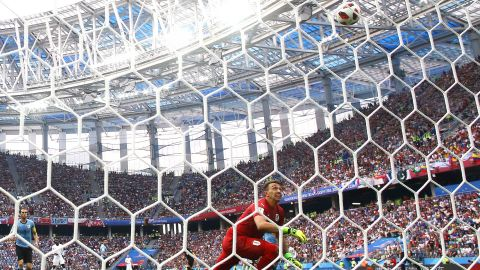 Uruguayan goalkeeper Fernando Muslera watches the ball leak into the net after he misplayed an Antoine Griezmann shot in the second half.