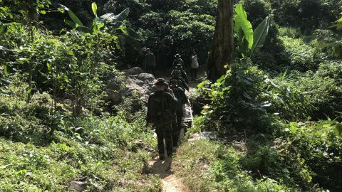 Members of a Thai military rescue team cross a bridge near Doi Pha Nee, a mountain to the northwest of a cave system where a boys' soccer team has been trapped for nearly two weeks.