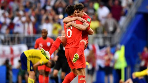 English defenders Harry Maguire, left, and John Stones celebrate their quarterfinal victory over Sweden on July 7. Maguire scored the opening goal in the 2-0 win.
