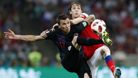 Croatia's Mario Mandzukic, left, and Russia's Mario Fernandes go for the ball.