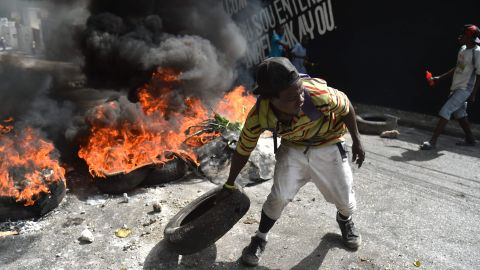 TOPSHOT - Protesters barricade a street in the Port-au-Prince suburb of Petion-Ville on July 7, 2018, to protest against the increase in fuel prices.  Haiti's Prime Minister, Jack Guy Lafontant, on Saturday called for patience from residents of the Caribbean nation amid deadly protests over an unpopular fuel price rise. At least one person has died there in the past day. The capital has stood paralyzed since July 6, following the government announcement that gasoline prices would rise by 38 percent, diesel by 47 percent and kerosene by 51 percent starting this weekend.   / AFP PHOTO / HECTOR RETAMALHECTOR RETAMAL/AFP/Getty Images