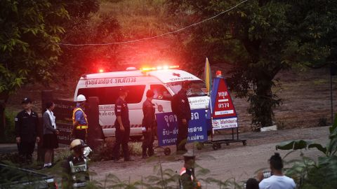 An ambulance leaves the Tham Luang cave area after divers evacuated some of the 12 boys and their coach trapped at the cave in Khun Nam Nang Non Forest Park in the Mae Sai district of Chiang Rai province on July 8, 2018. - Elite divers on July 8 began the extremely dangerous operation to extract 12 boys and their football coach who have been trapped in a flooded cave complex in northern Thailand for more than two weeks, as looming monsoon rains threatened the rescue effort. (Photo by LILLIAN SUWANRUMPHA / AFP) /         (Photo credit should read LILLIAN SUWANRUMPHA/AFP/Getty Images)