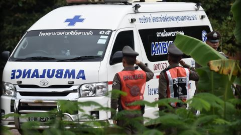 An ambulance exits the cave area on July 9.