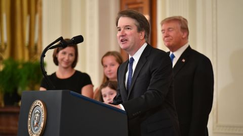 Supreme Court nominee Brett Kavanaugh speaks while his wife Ashley Estes Kavanaugh (L) and US President Donald Trump listens after the announcement of his nomination in the East Room of the White House on July 9, 2018 in Washington, DC. (Photo by MANDEL NGAN / AFP)        (Photo credit should read MANDEL NGAN/AFP/Getty Images)