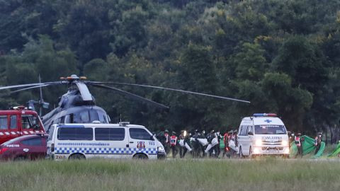 An ambulance believed to be carrying one of the rescued boys heads to the hospital on July 10.