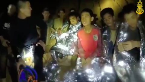 Members of the Royal Thai Navy are pictured with the 12 schoolboys, members of a local soccer team, and their coach, who were trapped in the Tham Luang Cave network in Northern Thailand.