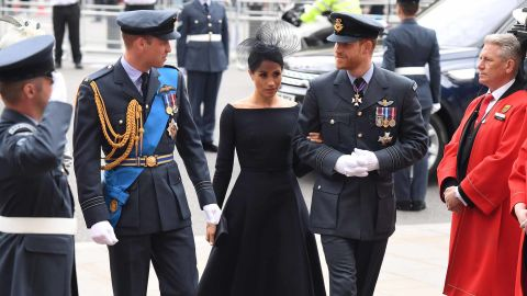 Prince William (L),  Prince Harry (R) and Meghan, Duchess of Sussex (C), arrive for the service.