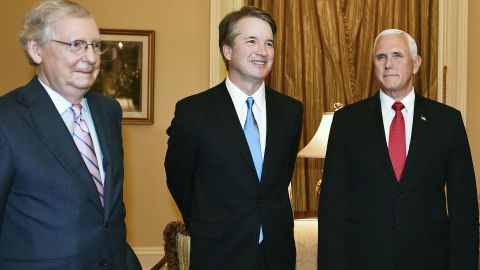 (L-R)US Senate Majority Leader Mitch McConnell, Supreme Court associate justice nominee Brett Kavanaugh and US Vice President Mike Pence pose in McConnell's office in the US Capitol in Washington, DC on July 10, 2018. (Photo by MANDEL NGAN / AFP)        (Photo credit should read MANDEL NGAN/AFP/Getty Images)