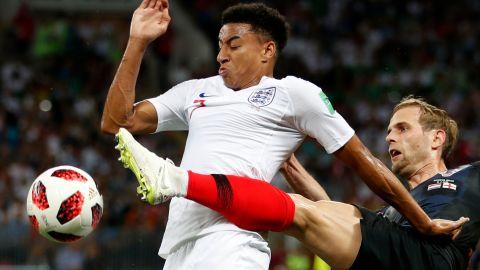 Croatia's Ivan Strinic, right, challenges England's Jesse Lingard.