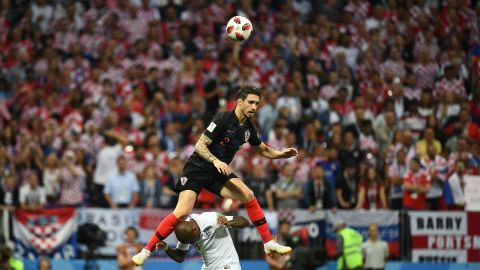 Croatian defender Sime Vrsaljko goes over Ashley Young for a header.