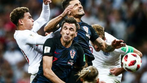 Players collide during the Croatia-England semifinal. Croatia played 120 minutes for the third straight match.