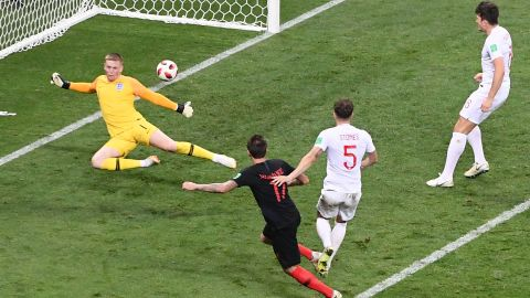 Mario Mandzukic scores against England late in extra time to give Croatia a 2-1 victory in the semifinals on Wednesday, July 11.